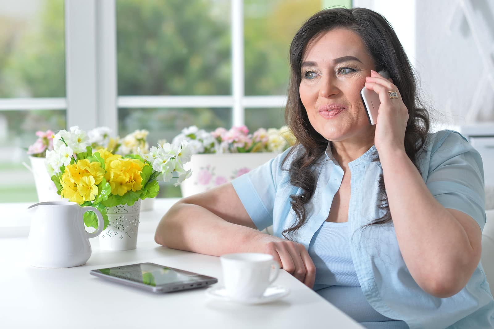 What hormones imbalance causes hot flashes- woman talking on phone