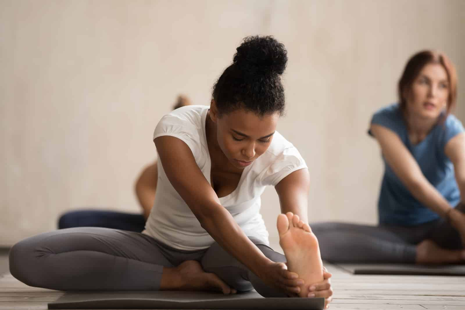Yoga to beat bloat on Thanksgiving and stimulate digestion- janu sirshasana