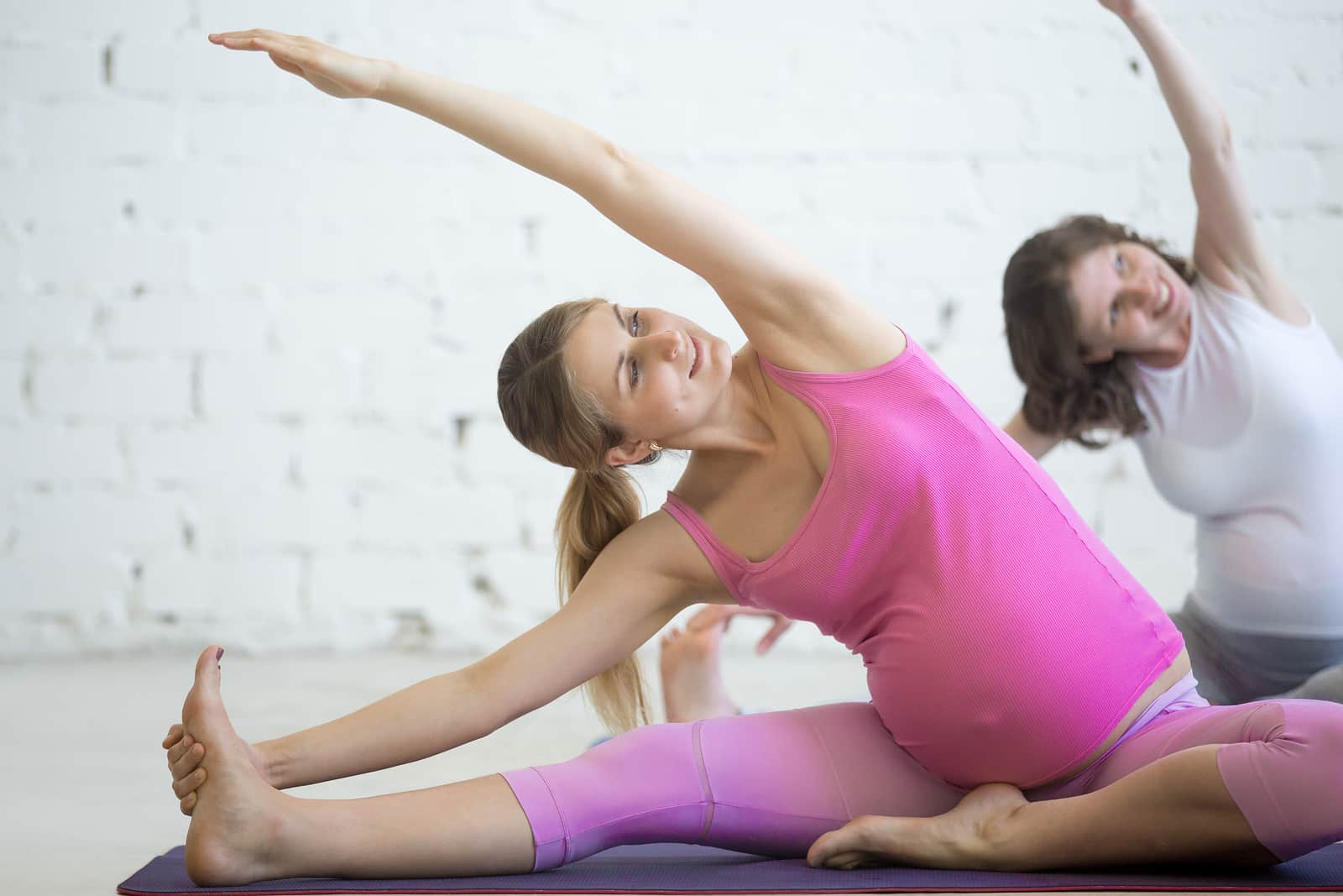 Try yoga to beat bloat on Thanksgiving- pregnant janu sirshasana modification
