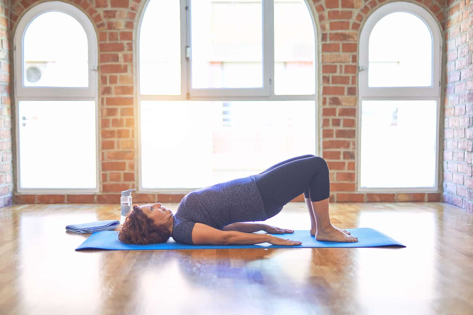 Woman doing bridge pose for insomnia relief- hormones