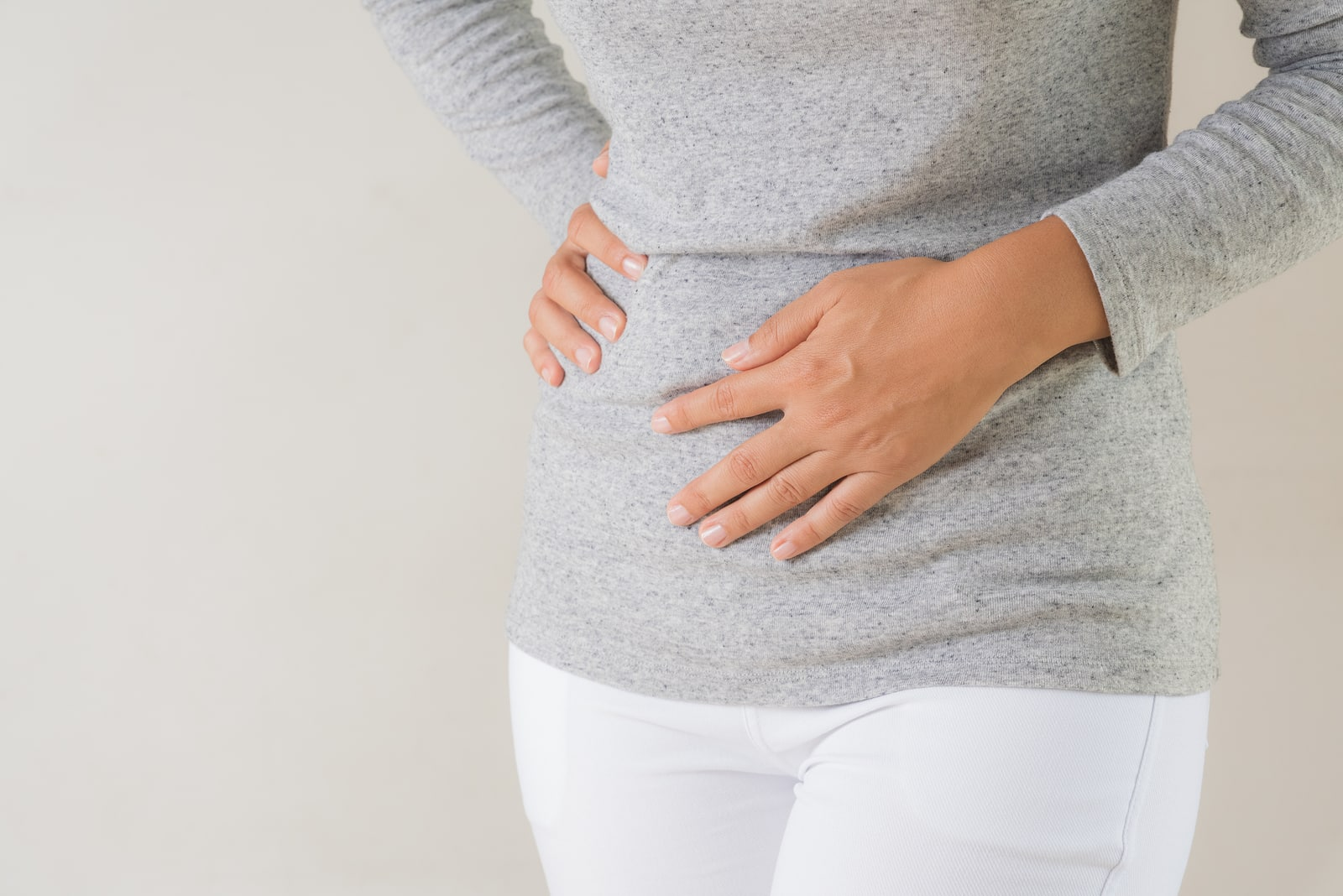 Woman feeling bloated from PMS