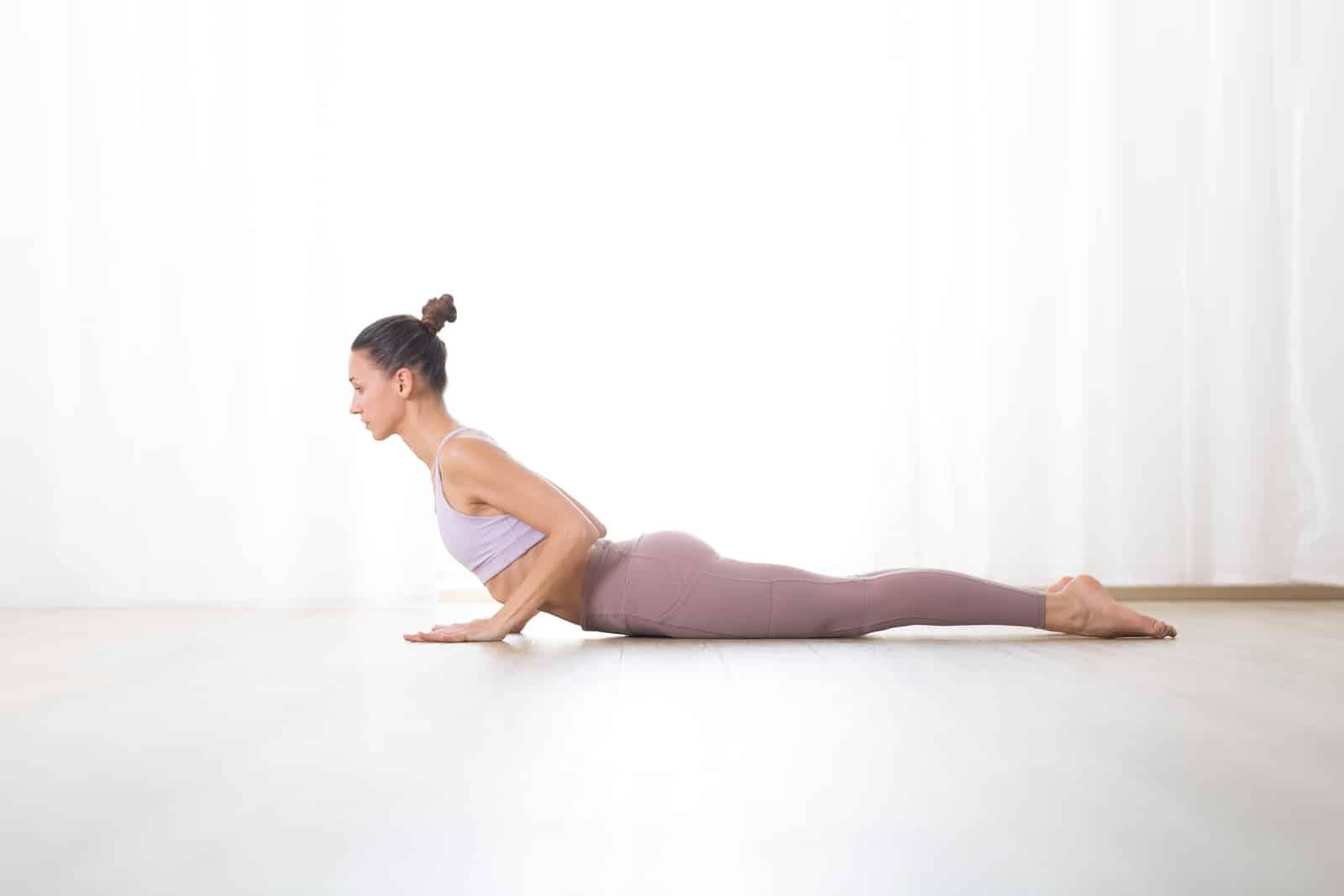 woman doing cobra pose. yoga for endometriosis pain