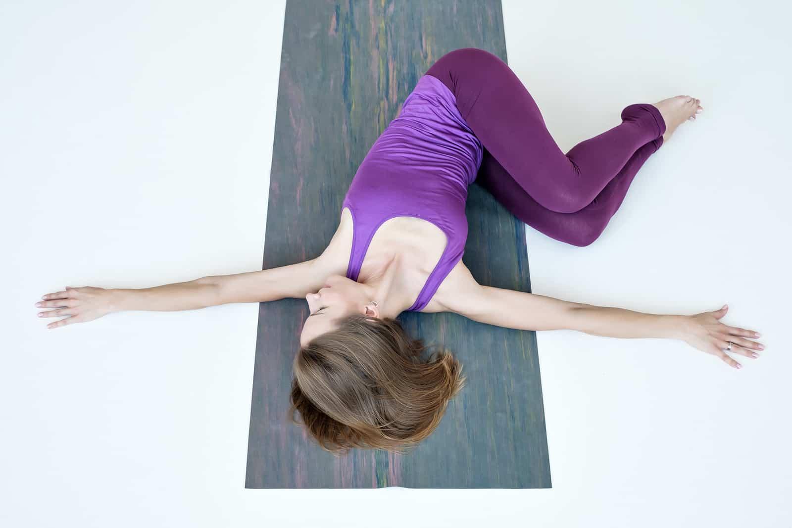 yoga for endometriosis pain: woman doing knee-down twist