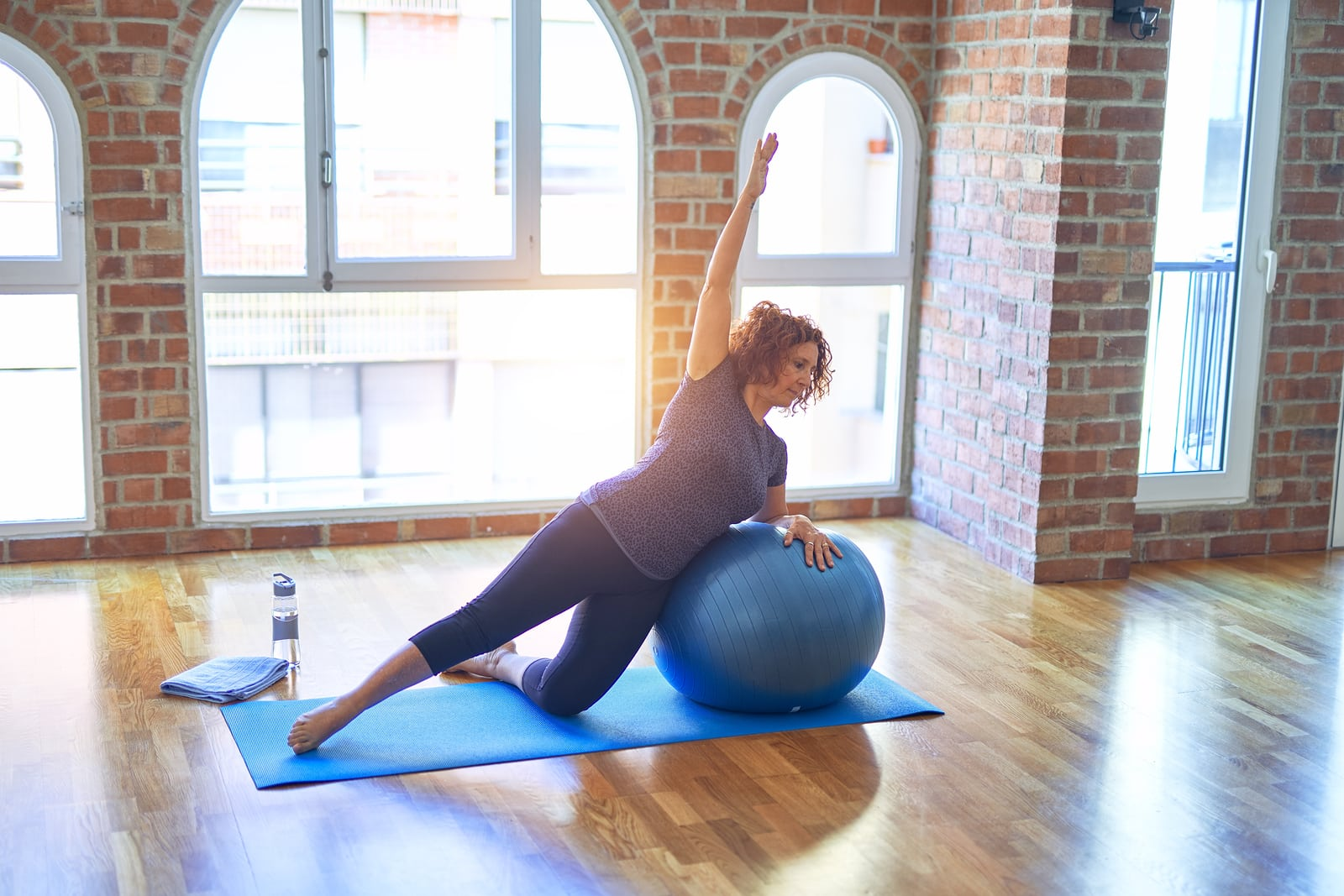 Woman exercising with medicine ball- exercise motivation at home