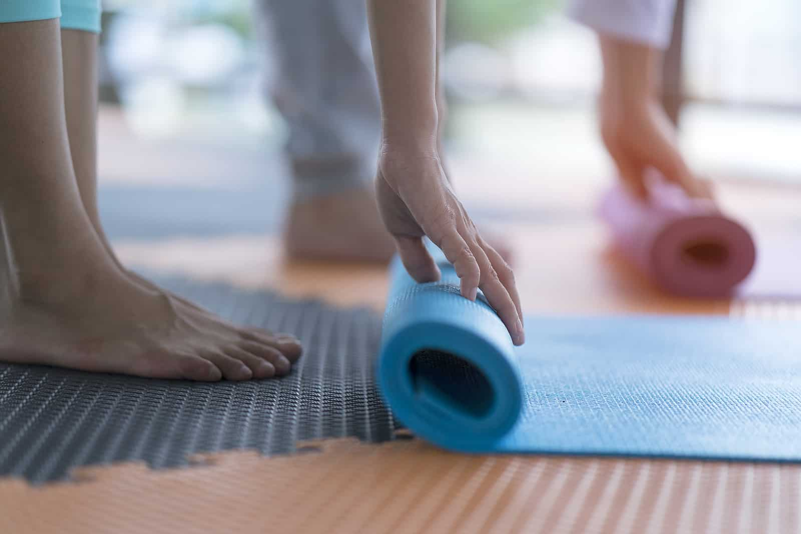 How to clean a yoga mat during COVID- studio class rolling up mats