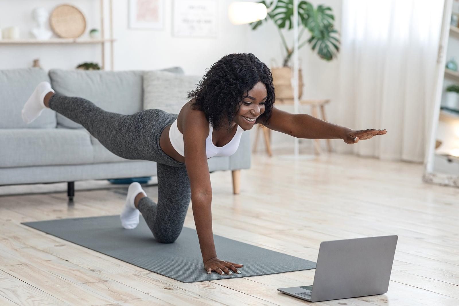 Can I do yoga or exercise after COVID-19 vaccine? Woman exercising at home.