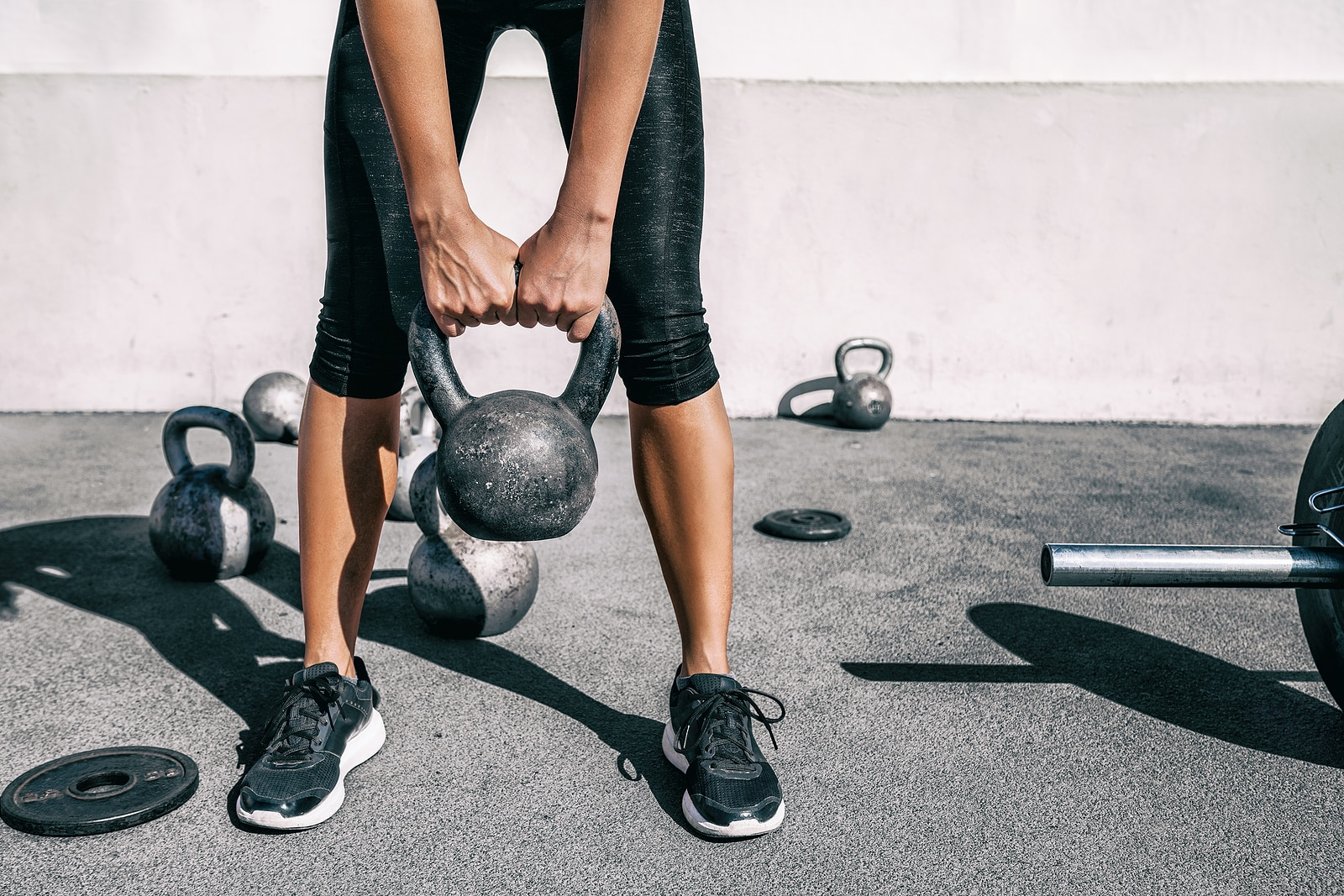 Stress of over exercise can affect gut health- woman doing intense workout