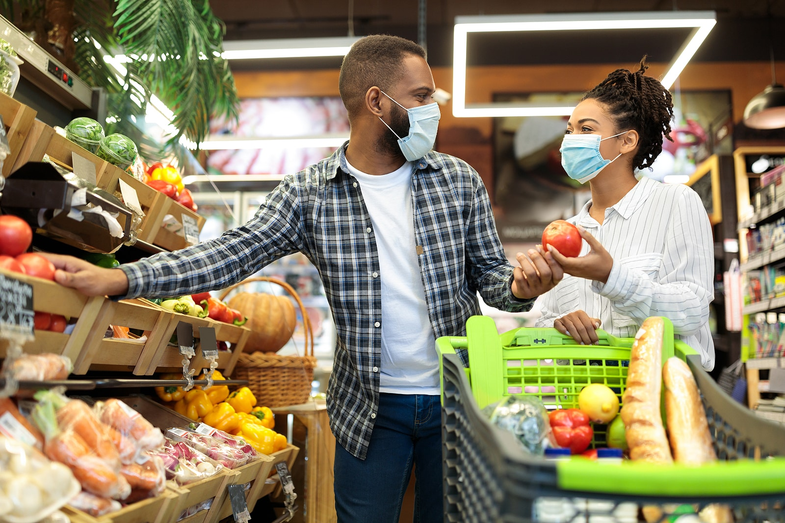 Couple shopping in masks