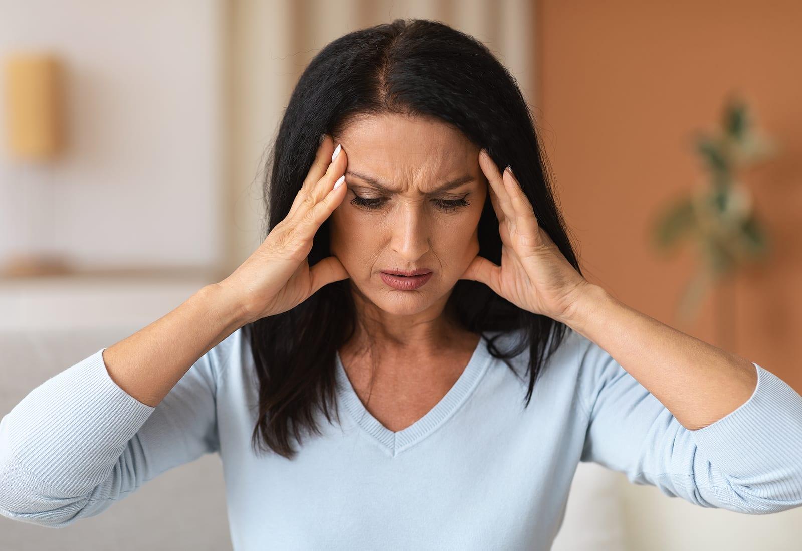 side effects of valerian root vs. melatonin- woman with headache
