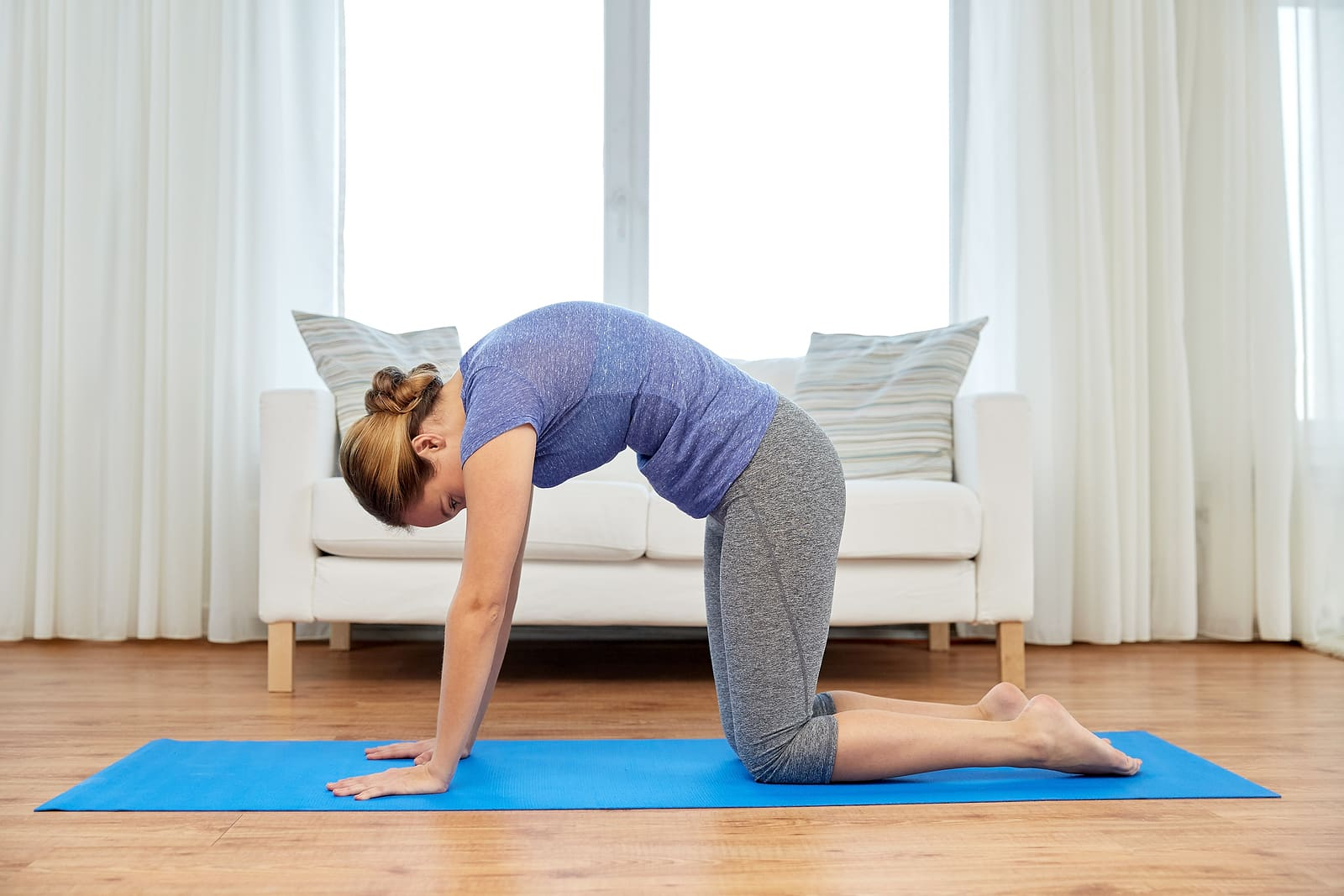 Yoga for PCOS- woman doing cat cow