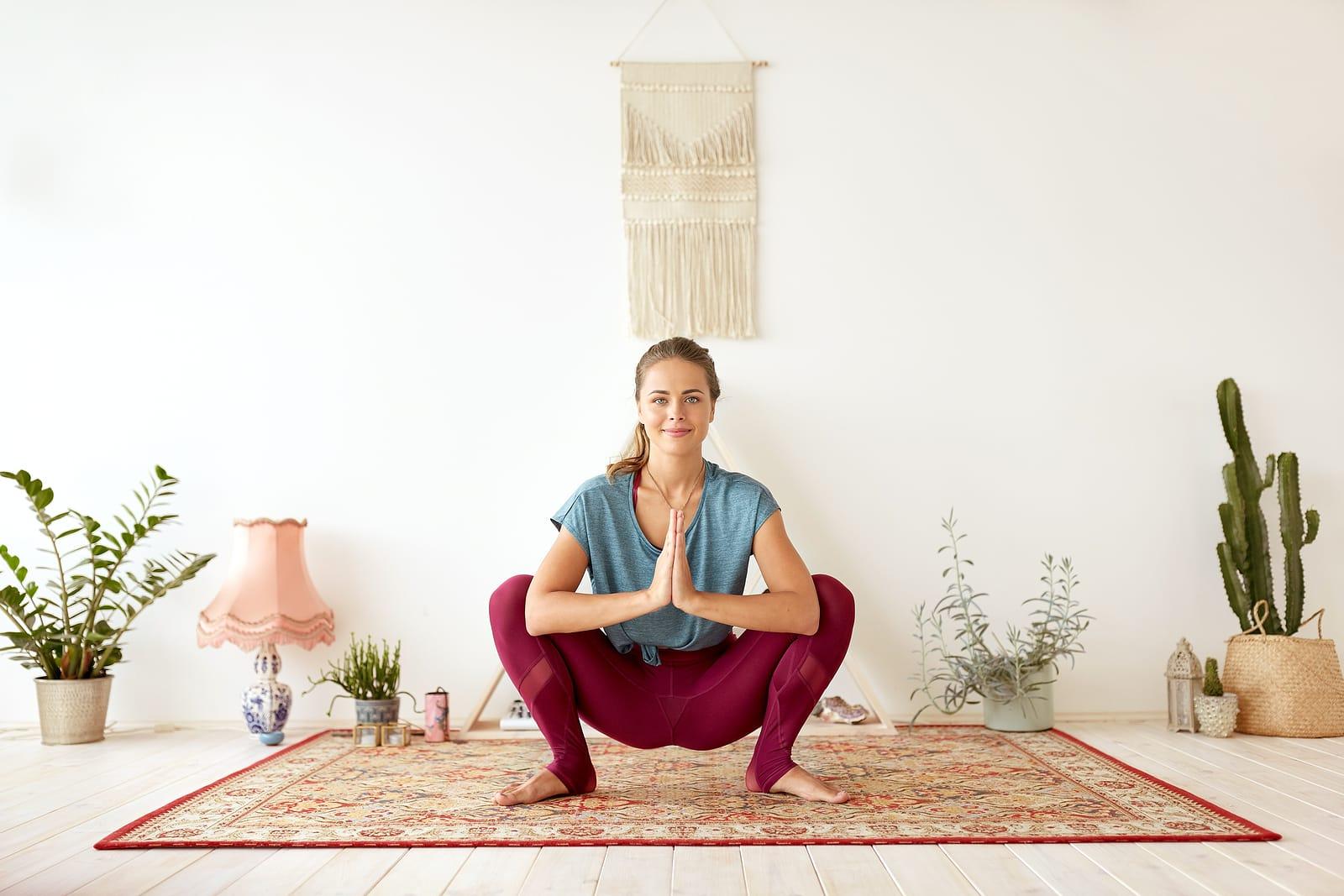 Yoga for pcos- woman doing malasana