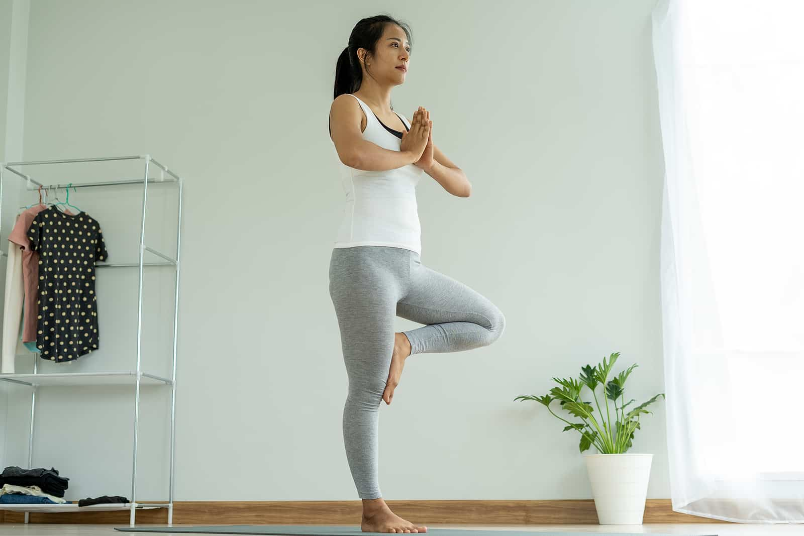 Yoga for polycystic ovarian syndrome- woman doing tree pose