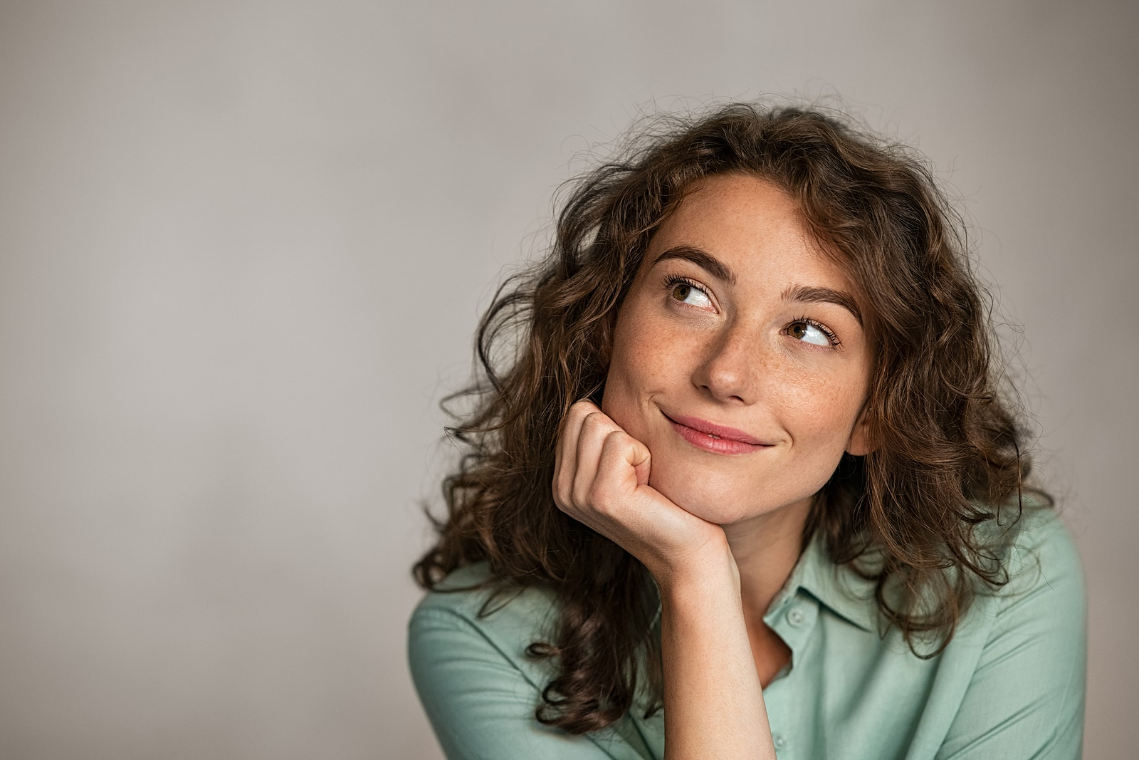 Emotional stress and pelvic pain- there is hope- woman feeling hopeful, smiling