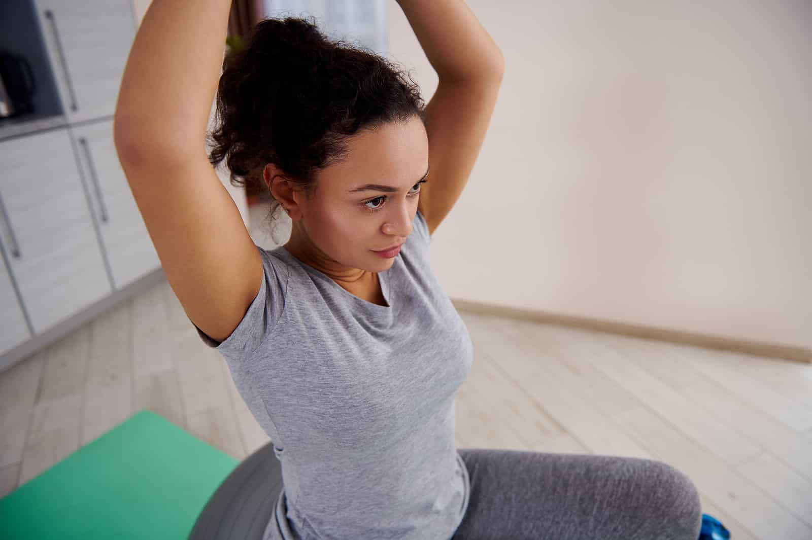 Woman on exercise ball as part of pelvic floor physical therapy