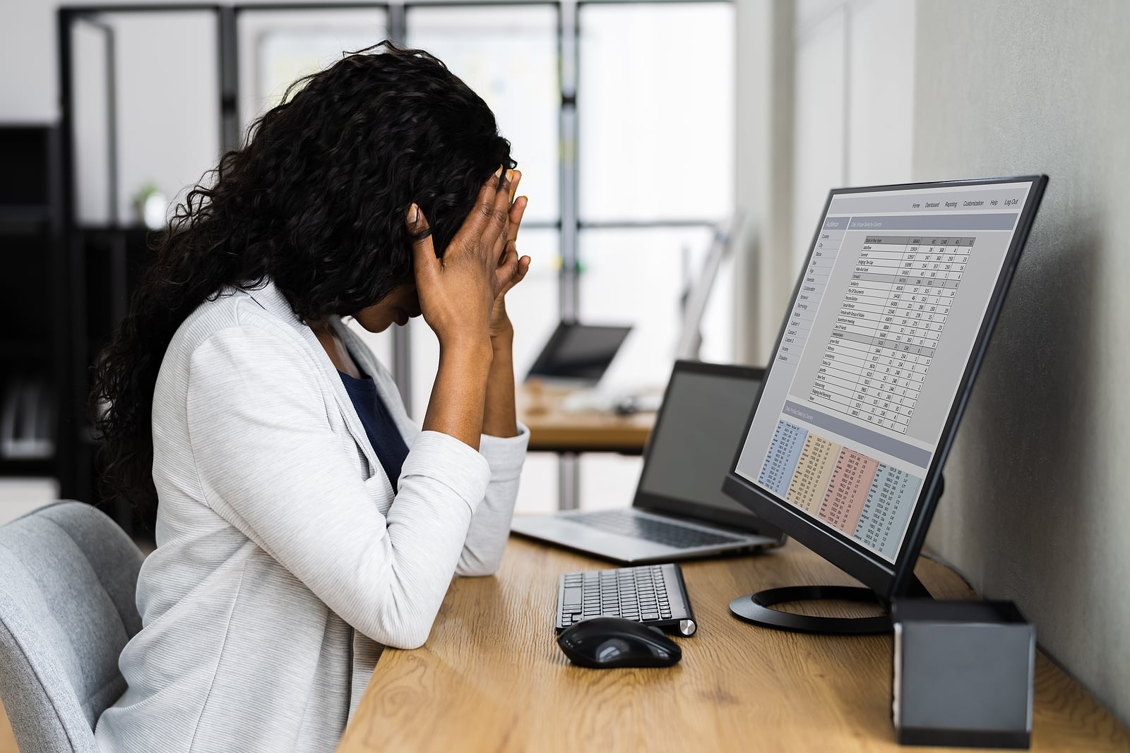 Why am I always tired? Woman stressed looking at computer screen
