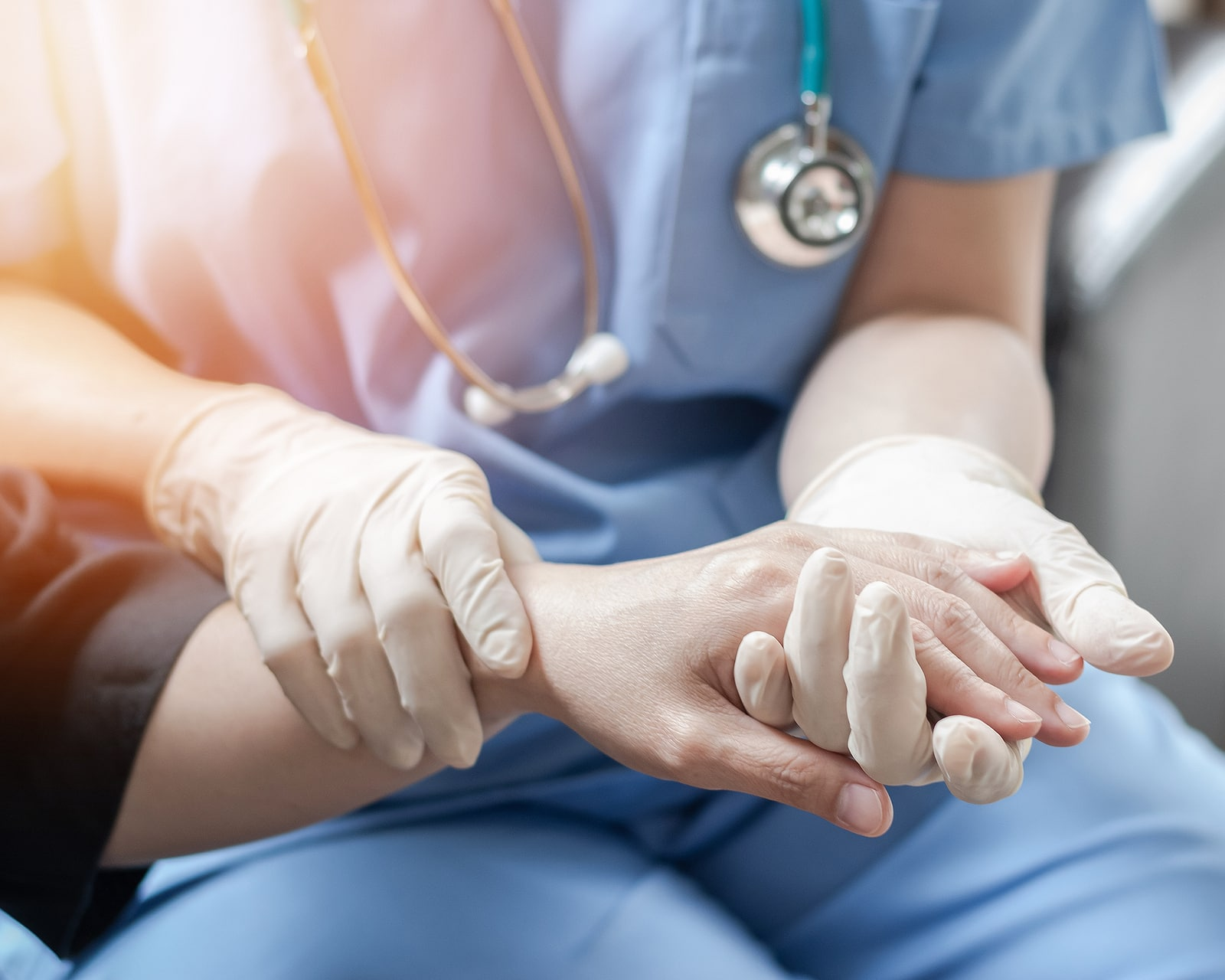 Why anxiety has such an affect on the body- hands of healthcare professional examining hands of a patient